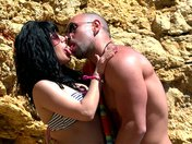 Threesome filmed in immersion on a beach
