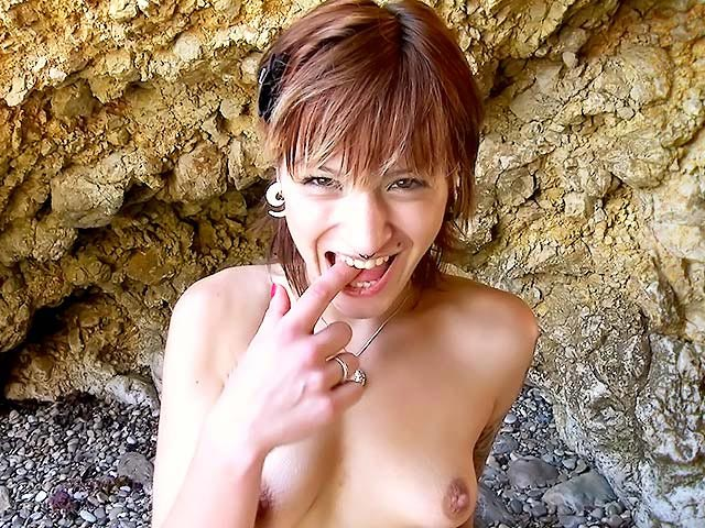 Tattooed young girl offers her pussy on a beach