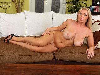 Britney shows off her big tits on the sofa