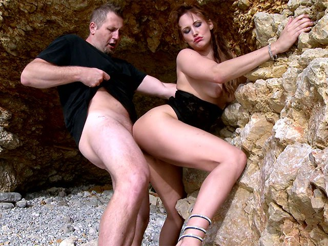Emy the redhead gets fucked on a rock