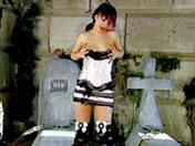 Scopata in fondo ad un cimitero