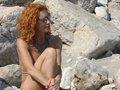 Rouquine mature en trio avec son mari et son amant sur la plage