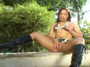 A young Latina dildoes herself in a public garden!!! sex video