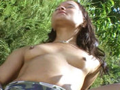 A young Latina dildoes herself in a public garden!!! xxx video