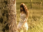 She is dancing naked by the waterside... xxx videos
