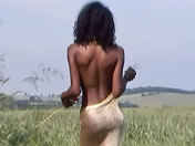 Beautiful black Anaïs fondles herself on the fields.  sex video