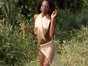 Beautiful black Anaïs fondles herself on the fields.  adult video