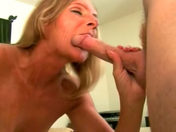 The mature slut licks her chops at wad