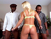 A blonde gets her anus torn up by two well-hung black men porn video