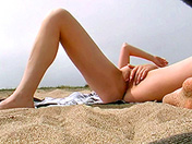A voyeur films a college girl on the sly on a nudist beach adult video
