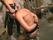 Slave subdued and humiliated by his torturer