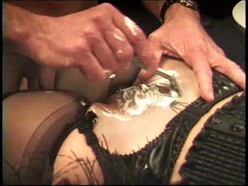 A female dwarf gets her pussy shaved by a handsome hunk.