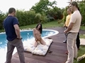 Gang bang by a swimming pool for a young brunette