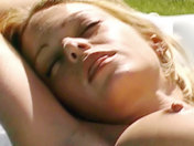 A sexy redheaded babe caresses herself by her swimming pool! xxx video